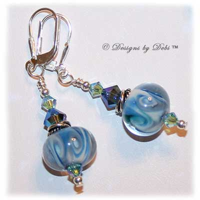 Designs by Debi Jewelry for Charity Set July 2011 Swirling Ocean Surf to benefit the American Red Cross. A beautiful, one of a kind handmade lampwork bracelet and earrings set in swirling blue, white and hints of green, swirled Bali silver beads, twisted rings and elegantly scrolled toggle clasp accented with Swarovski crystal bicones in aquamarine ab2x and montana ab2x. OOAK © Designs by Debi All Rights Reserved