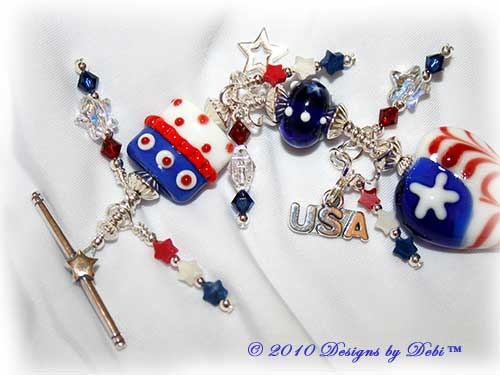 Designs by Debi Jewelry for Charity Piece for June 2010 to raise money for Soldiers' Angels. A one-of-a-kind artisan handmade bracelet with red, white and blue flag motif handmade glass beads, swarovski crystal siam and dark sapphire bicones, Swarovski Crystal and Crystal AB stars, red, white and blue howlite stars, sterling silver star, heart-shaped flag and USA charms and a sterling silver star toggle clasp. OOAK