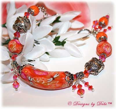 Can't Wait for Spring! Designs by Debi Jewelry for Charity Bracelet March 2011 A fun, one of a kind handmade bracelet of orange, pink and white polymer clay beads with flowers and dragonflies, Bali silver beads, Swarovski crystals and sterling silver. OOAK