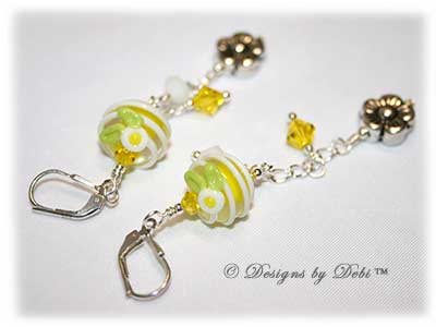 Designs by Debi Handmade Jewelry for Charity Bracelet and Earrings Set Hope for a Bright Future. The one of a kind ooak bracelet features handmade artisan lampwork glass beads, sterling silver flower beads, Swarovski citrine and white alabaster bicones, a sterling silver hook clasp and extender chain with charms. The one of a kind earrings are leverback style with matching beads, crystals and chain.