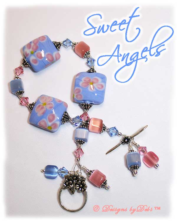Designs by Debi Handmade Jewelry Sweet Angels one of a kind ooak handmade light pink and light blue lampwork and crystal bracelet made in honor of national pregnancy and infant loss awareness month to raise money for Missing GRACE Foundation. It was made with pink flowers on blue handmade square lampwork beads, pink and blue cat's eye beads, pink and blue crystals and sterling silver with a flower toggle clasp.