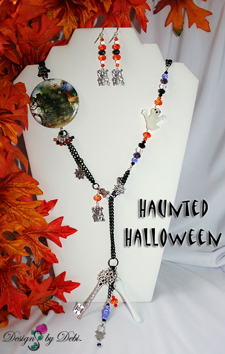 Designs by Debi Handmade Jewelry for Charity Set October 2012 to benefit Born This Way Foundation. A one of a kind Halloween theme lariat necklace and earrings made with Swarovksi and other crystals in black, black diamond, fire opal and purple velvet, a unique Haunted House focal piece, black curb chain, a white glass ghost, haunted house, spider web and padlock charms, a white glass bone pendant bead and a large silver skeleton key. Copyright Designs by Debi.