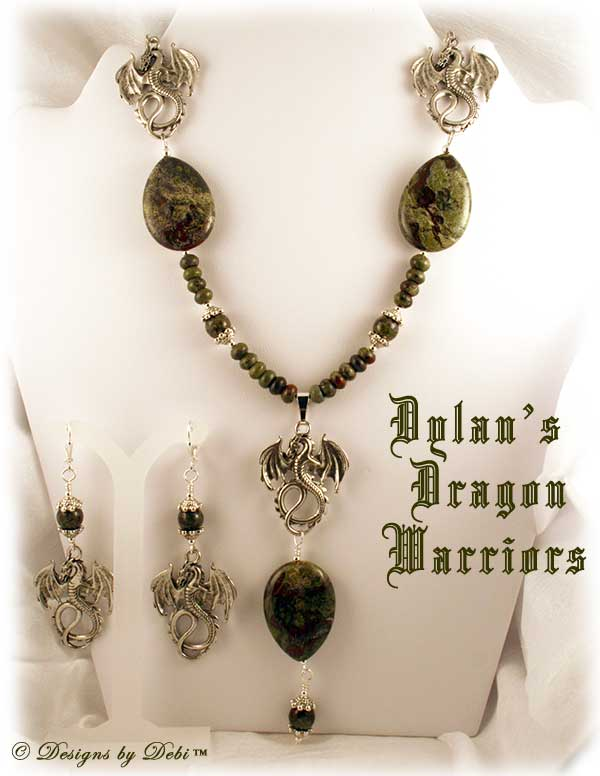 Designs by Debi Handmade OOAK Jewelry for Charity Necklace and Earrings Set for August 2011 called Dylan's Dragon Warriors. Made with multiple pewter dragons, green and red dragon blood jasper in teardrop, round and rondelle shapes and pewter dragon feet bead caps.