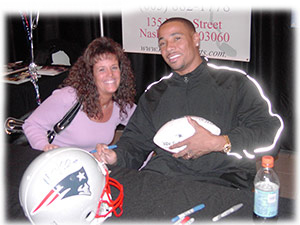 Debi with Rodney Harrison of the New England Patriots
