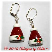Red glass santa hat handmade silver lever back earrings.