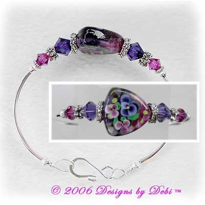 Designs by Debi Handmade Jewelry Pansy Shield Triangle Artisan Handmade Lampowork Focal Bead and Swarovski Crystal Fuchsia and Purple Velvet Bicones Silver Fitted Bangle Bracelet with Hook Clasp ~ OOAK