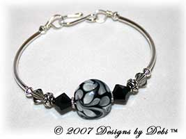 Designs by Debi Handmade Jewelry Black, Gray and White Swirled Lentil Glass Focal Bead and Swarovski Crystal Jet and Black Diamond Bicones Silver Fitted Bangle Bracelet with Hook Clasp