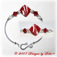 Designs by Debi Handmade Jewelry Red and White Raked Diamond Artisan Handmade Lampwork Focal Bead and Swarovski Crystal Siam and Crstal Bicones Silver Fitted Bangle Bracelet with Hook Clasp