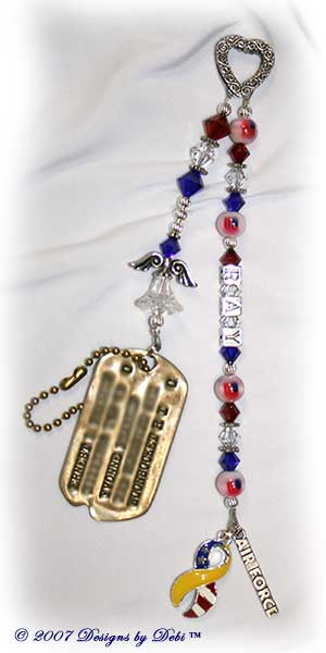 Guardian Angel Prayer Chain™ with ornate textured Bali fine silver heart, Swarovski siam red, clear crystal and cobalt blue bicone crystals, star spacer beads, fiber-optic flag beads, round silver beads, Ray in sterling silver block letters, combo ribbon charm half yellow and half flag, Air Force charm, beaded angel and dog tag.