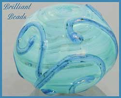 Glacier Blue Scrollwork Hollow Lampwork Bead handmade by Gillian Soskin of Brilliant Beads