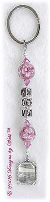 Handmade key chain with Mom in alphabet letter cubes, pink aloha glass beads, rose pink Swarovski crystals and a picture frame charm.