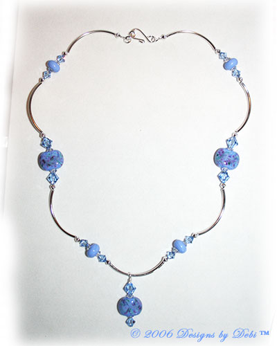 Morning Glory one-of-a-kind handmade artisan lampwork, Swarovski crystal and silver curved tube bead necklace in periwinkle blue with a hook clasp.