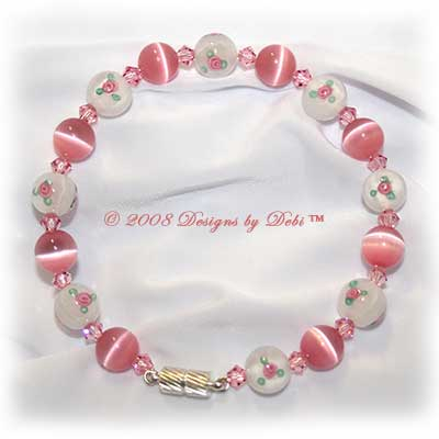 Designs by Debi Handmade Jewelry Pink Cat's Eye, Swarovski Crystal Light Rose Pink Bicones and White Glass Beads with Rosebuds Bangle Style Memory Wire Bracelet with Silver Magnetic Clasp