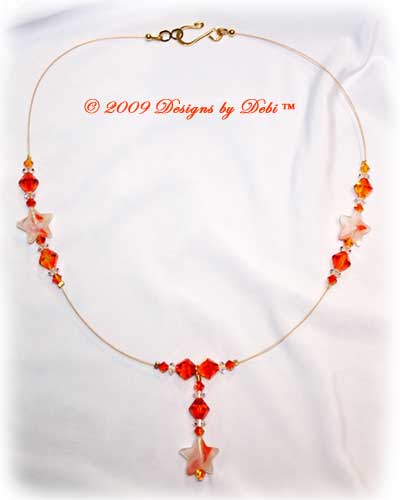 Designs by Debi Handmade Jewelry White & Orange Stars and Swarovski Crystal Fire Opal Bicones Gold Wire Floating Necklace with a Gold Hook Clasp