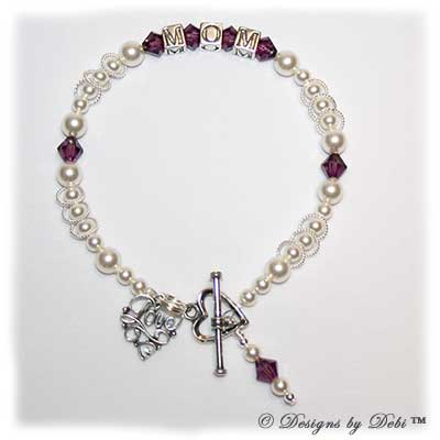 Designs by Debi Handmade Jewelry This is the Isabella Style Bracelet in the Pearls bead combination with Amethyst (February) crystals, a Heart toggle clasp, Love Filigree charm and Amethyst birthstone dangle.