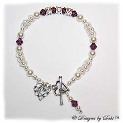 Designs by Debi Handmade Jewelry Keepsake Bracelet in the Isabella Style Pearls bead combination with Amethyst (February) crystals, a Heart toggle clasp, Love Filigree charm and Amethyst birthstone dangle.  Mother's Bracelet Wedding Bracelet
