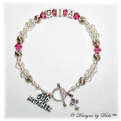 Designs byDebi Handmade Jewelry Isabella Style Bracelet in the Twist and Pearls bead combination with Rose (October) crystals, a Bright Twisted Rope toggle clasp, Godmother charm and additional Cross charm.
