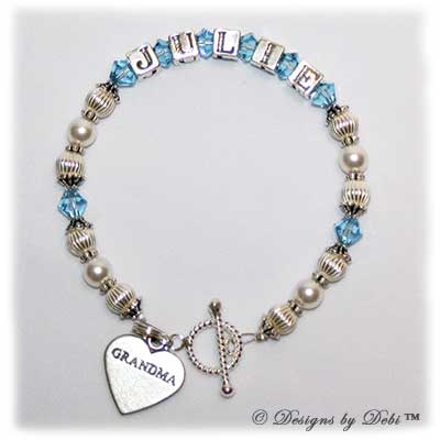 Designs by Debi Handmade Jewelry Jasmine Style Bracelet in the Corrugated and Pearls bead combination with Aquamarine (March) crystals, a bright twisted rope toggle clasp and Grandma heart charm.