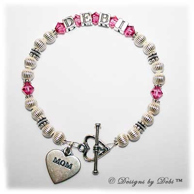 Designs by Debi Handmade Jewelry Kiara Style Bracelet in the Corrugated bead combination with Rose (October) crystals, a heart toggle clasp and Mom heart charm.
