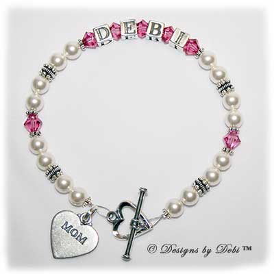 Designs by Debi Handmade Jewelry Kiara Style Bracelet in the Pearls bead combination with Rose (October) crystals, a heart toggle clasp and Mom heart charm.