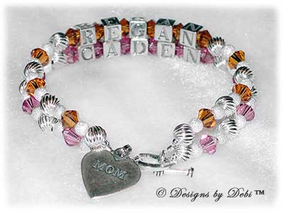 Designs by Debi Handmade Jewelry Melania Style Bracelet in the Twist and Stardust bead combination with Topaz (November) and Rose (October) crystals, a Heart toggle clasp and Mom heart charm.
