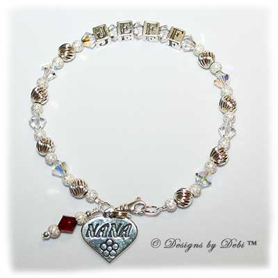 Designs by debi Handmade Jewelry Melania Style Bracelet in the Twist and Stardust bead combination with Crystal AB crystals, a small swivel lobster clasp, Nana heart charm and Siam (July) birthstone dangle.