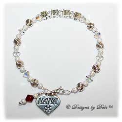 Designs by Debi Handmade Jewelry Keepsake Bracelet in the Melania Style Twist and Stardust bead combination with Crystal AB crystals, a small swivel lobster clasp, Nana heart charm and Siam (July) birthstone dangle Grandmother's or Nana's Bracelet