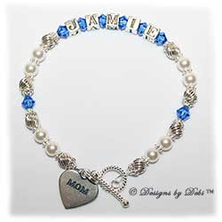 Designs by Debi Handmade Jewelry Keepsake Bracelet in the Samantha Style Twist and Pearls bead combination with Sapphire (September) crystals, a bright twisted rope toggle clasp and Mom heart charm. Mother's Bracelet