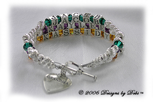 Designs by Debi Handmade Jewelry 3 strand Keepsake Bracelet in the Karen Style Twist bead combination with Emerald (May), Amethyst (February) and Topaz (November) crystals, a heart toggle clasp and Grandma heart charm. Grandmother's or Nana's Bracelet