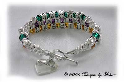Designs byDebi Handmade Jewelry 3 strand Karen Style Bracelet in the Twist bead combination with Emerald (May), Amethyst (February) and Topaz (November) crystals, a heart toggle clasp and Grandma heart charm.