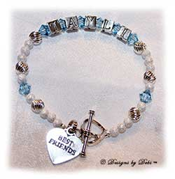 Designs by Debi Handmade Jewelry Personalized Keepsake Bracelet in the Karen Style Twist and Stardust bead combination with Aquamarine (March) crystals, a heart toggle and Best Friends heart charm. Best Friends Bracelet