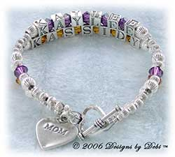 Designs by Debi Handmade Jewelry 2 strand Keepsake Bracelet in the Karen Style Corrugated bead combination with Amethyst (February) and Topaz (November) crystals, a heart toggle clasp and Mom heart charm.  Mother's Bracelet