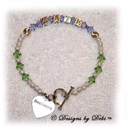 Designs by Debi Handmade Jewelry Keepsake Bracelet in a customized version of the Karen Style Twist and Stardust bead combination with Alexandrite (June alt.) and Peridot (August) crystals, a heart toggle and Daughter heart charm. Daughter's Bracelet