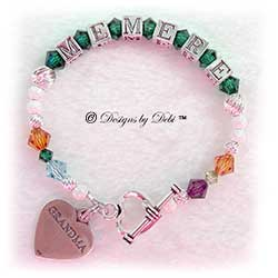 Designs by Debi Handmade Jewelry Personalized Generations Keepsake Bracelet in the Karen Style Twist and Stardust bead combination (altered for a very small wrist) with every family member's birthstone, a heart toggle clasp and Grandma heart charm. Grandmother's or Nana's Bracelet