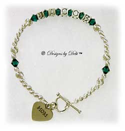Designs by Debi Handmade Jewelry Personalized Keepsake Bracelet in the Karen Style Twist bead combination with Emerald (May) crystals, a heart toggle clasp and Mom heart charm. Mother's Bracelet