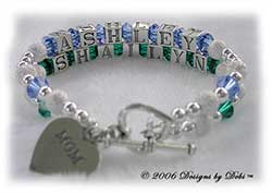 Designs by Debi Handmade Jewelry Personalized Keepsake Bracelet 2 strand Keepsake Bracelet in the Karen Style Stardust and Seamless Round bead combination with Sapphire (September) and Emerald (May) crystals, a heart toggle clasp and Mom heart charm.  Mother's Bracelet