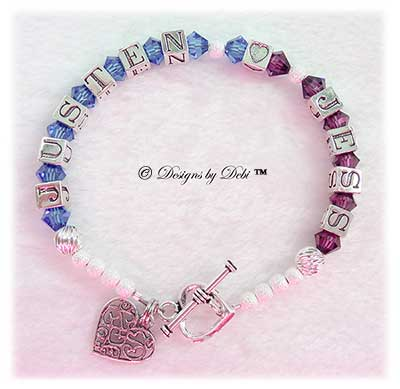 Designs by Debi Handmade Jewelry Karen Style Couples Keepsake Bracelet in the Twist and Stardust bead combination with Sapphire (September) and Amethyst (February) crystals, a heart toggle clasp and Filigree Hearts in Heart charm.