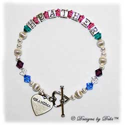 Designs by Debi Handmade Jewelry Family Keepsake Bracelet in the Karen Style Corrugated bead combination with every family member's birthstone, a heart toggle clasp and Grandma heart charm.Grandmother's or Nana's Bracelet