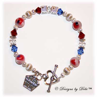 Designs by Debi Handmade Jewelry Personalized Remember 9/11 Bracelet Flags with red, white and blue Swarovski crystals, sterling silver and fiber optic flag beads, a heart toggle clasp and Remember charm with the Twin Towers and stars.