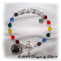 Designs by Debi handmade Rainbow Bridge Pet Memorial bracelet in sterling silver with the name Dawn in alphabet letter cubes, red, orange, yellow, green, blue, purple, crystal and crystal AB Swarovski crystals, a heart toggle, a paw print charm and a heart shape picture frame charm.
