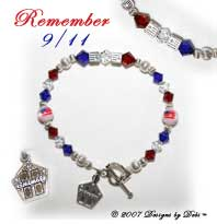 Designs by Debi Handmade Jewelry Remember 9/11 Sterling Silver Round and Flag Cube Beads and Swarovski Crystal Red, Crystal & Blue Bicones Bracelet with a Heart Toggle Clasp and Twin Towers Charm