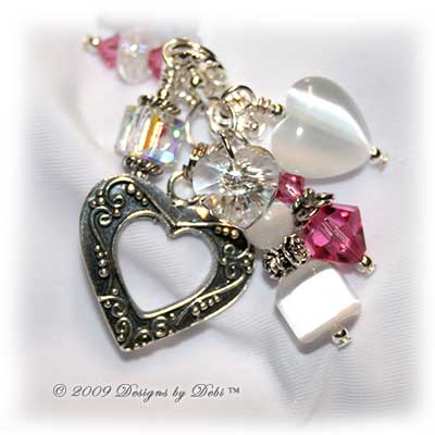 Roses on the Glistening Snow handmade lampwork, Bali silver, cat's eye and Swarovski crystal bracelet in pink, crystal AB, white and green with a heart toggle.
