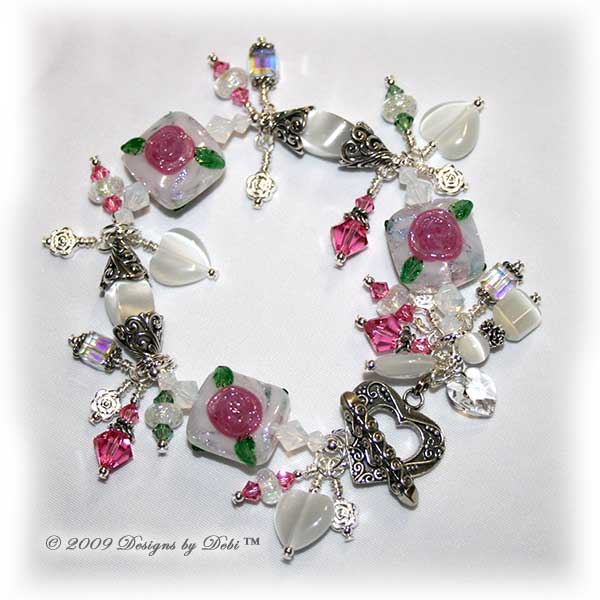 Roses on the Glistening Snow Handmade Bracelet made with artisan handmade lampwork beads, Bali silver, Swarovski crystal, and cat's eye with a toggle style clasp.