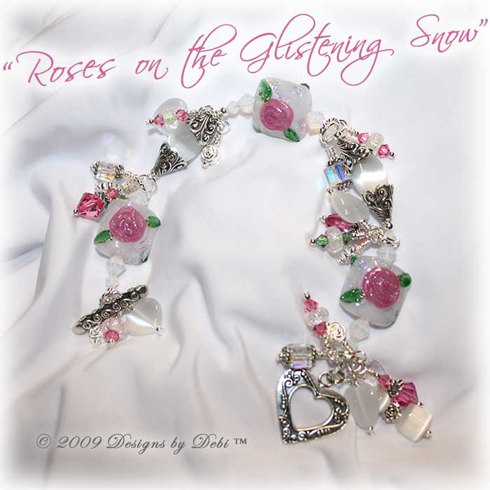 Roses on the Glistening Snow One-of-a-Kind Handmade Bracelet made with artisan handmade lampwork beads, Bali silver, Swarovski crystal, and cat's eye with a toggle style clasp.