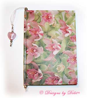 Sample photo of a Designs by Debi Handmade Jewelry ribbon slide style bookmark in use