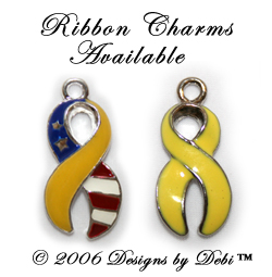 photo of ribbon charms for the Support Your Soldier Bracelet™ one is yellow and the other is halkf yellow half flag