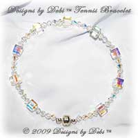 Designs by Debi Tennis Bracelet of Swarovski Crystal AB aurora borealis cube and bicone crystals with a magnet clasp.