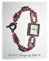 Handmade Rose AB Swarovski crystal watch with a silver rectangle face and round toggle clasp.