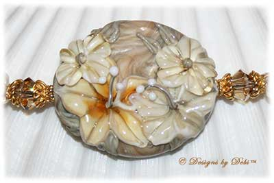 Designs by Debi Handmade Jewelry for Charity Necklace Sending Healing Aloha. A one of a kind ooak hibiscus lampwork necklace with freshwater pearls, gold beads, Bali floral pillow beads and a gold hibiscus toggle clasp.