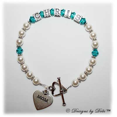 Designs by Debi Handmade Jewelry Ali Style Bracelet in the Pearls with Antiqued Daisies bead combination with Blue Zircon (December) crystals, a heart toggle clasp and Mom heart charm.